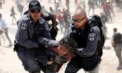 نظامیان صهیونیست حجاب را از سر زنان فلسطینی کشیدند