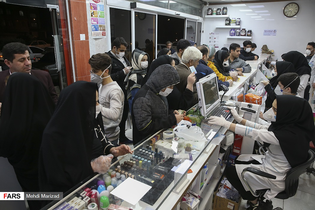 Iranians formed lines to buy masks and sanitary products at a pharmacy in Qom.