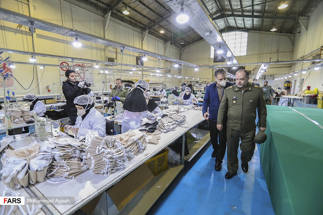 Military officials visited a mask production facility.
