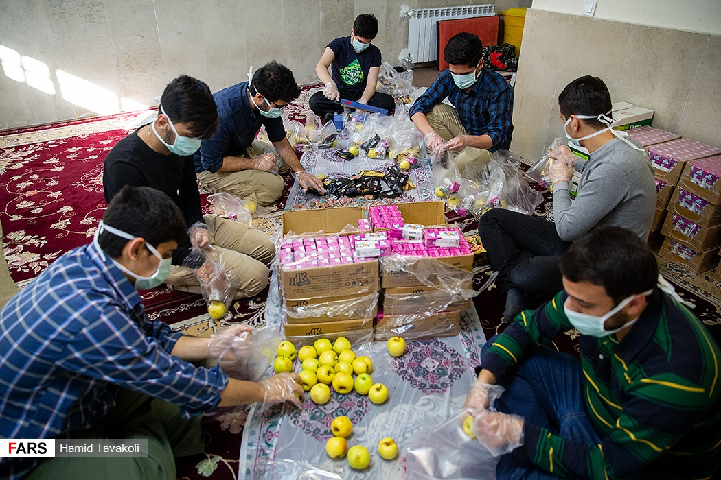 Men in Jamaran prepared food packages for local hospital patients.