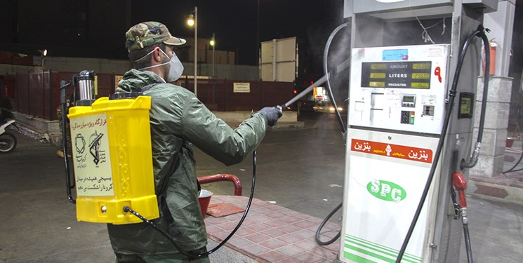 A Basij member disinfected a gas station in Jam.