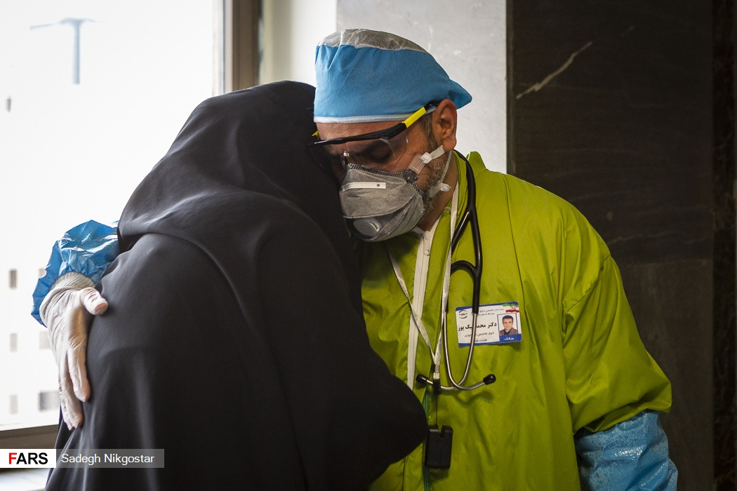 A doctor comforted a woman at a hospital in Tehran.