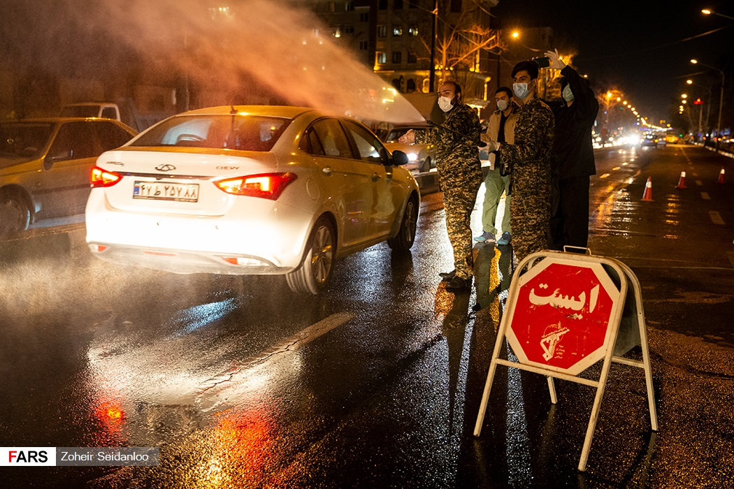 A roadblock to disinfect cars in Tehran