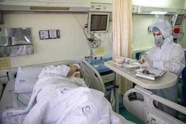 توزیع  غذای متبرک حرم امام رضا (ع) در بیماران بیمارستان میلاد