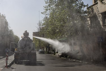 ضدعفونی معابر خیابان حجاب توسط  نیروهای جهادی قرارگاه مدافعان سلامت قمربنی هاشم