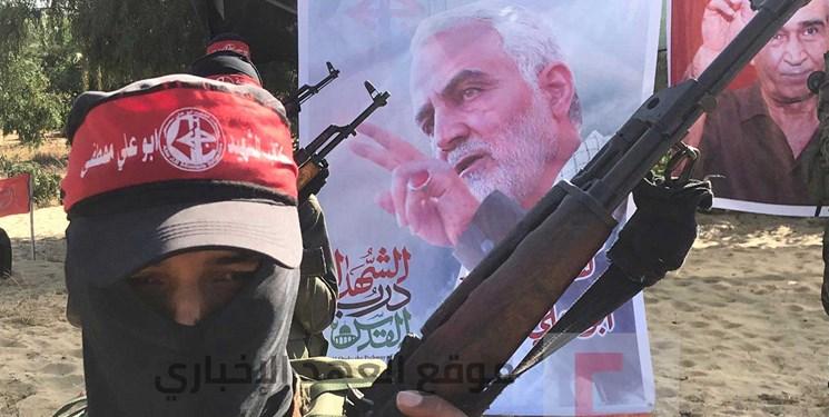 مانور جنبش فلسطینی به مناسبت روز قدس با تصاویری از سردار سلیمانی و نصرالله