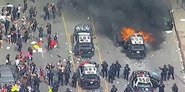 اعلام حکومت نظامی در چند شهر بزرگ آمریکا/ درگیری پلیس با معترضان در سراسر این کشور