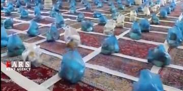 فیلم| کمک مؤمنانه در شهرستان بوئین زهرا/ توزیع 2 هزار بسته معیشتی