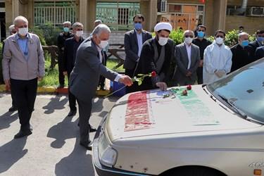 ادای احترام مقامات استانی به شهید مدافع سلامت