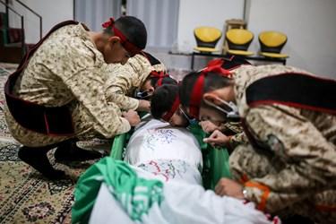 ادای احترام نیروهای دژبان معراج الشهدا به شهید مدافع حرم زکریا شیری