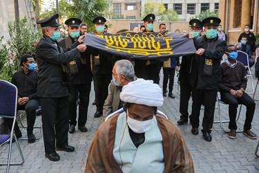 ورود پرچم متبرک حرم امام رضا(ع) به محل پنجمین اجلاسیه بین المللی مجاهدین در غربت