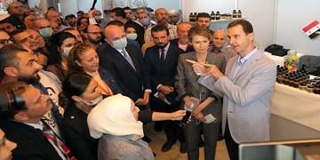 حضور رئیس جمهور سوریه و همسرش در نمایشگاهی در دمشق
