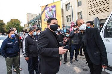 محمدرضا ساکت و محرم نویدکیا مدیرعامل و سرمربی تیم فوتبال سپاهان در مراسم تشییع مرحوم یاوری