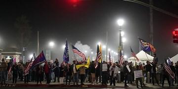 طرفداران ترامپ به محدودیتهای کرونایی اعتراض کردند و ماسک آتش زدند