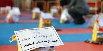 برگزاری آیین همدلی بر روی تاتامی/ توزیع بستههای معیشتی بین ورزشکاران کرمانشاه