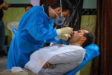 انجام ویزیت و معاینه دندان های آسیب دیده  افراد مراجعه کننده