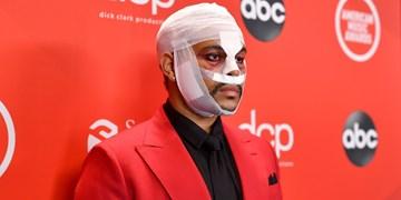 ماجرای صورت باندپیچی خواننده کانادایی/ دِ ویکند: هدفم اعتراض به فرهنگ پوچ هالیوود است!