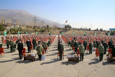 ادای احترام به سرود ملی در مراسم اختتامیه سیزدهمین جشنواره جوان سرباز