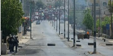 درگیری شدید فلسطینیان با نظامیان صهیونیست در کرانه باختری+فیلم