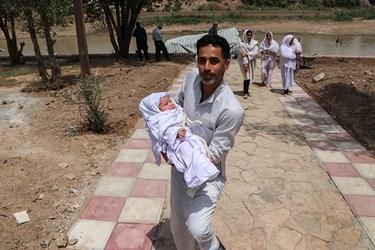 غسل تعمید کودکان مندایی در سوسنگرد