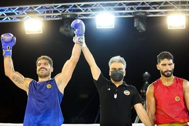 فینال مسابقات مبارزه جنگجویان ووشو (wwf)-وزن 90- کیلوگرم بین امیر فضلی و سجاد پورجهانی