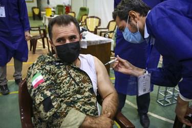 مرکز تجمیعی واکسیناسیون کرونا شهید مدافع سلامت صالح مهدوی مجد نیروی زمینی سپاه پاسداران