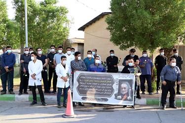 ادای احترام همکاران به شهید مدافع سلامت