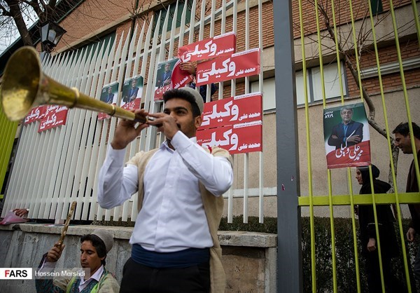 A musician performed in front of campaign posters in Tehran