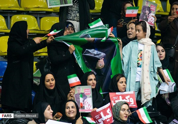 Women held campaign posters during an election rally in Tehran
