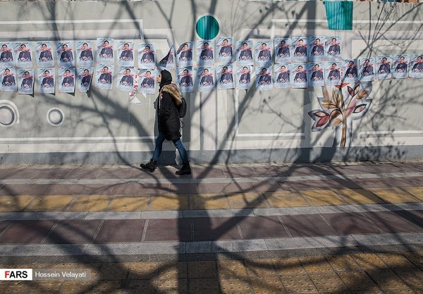 A woman walked past campaign posters in Tehran