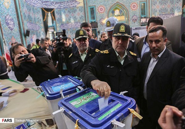 Revolutionary Guards officials cast their votes in Tehran