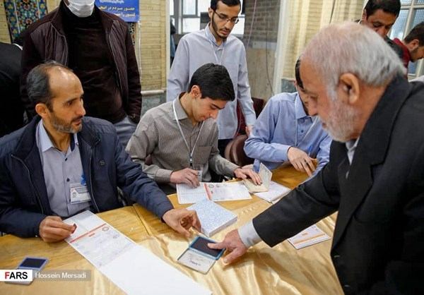 A man verified his identity with a finger print before submitting his ballot