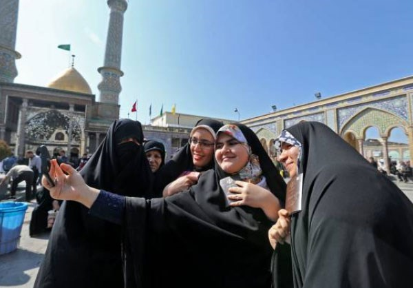 Women posed for a picture before casting their votes