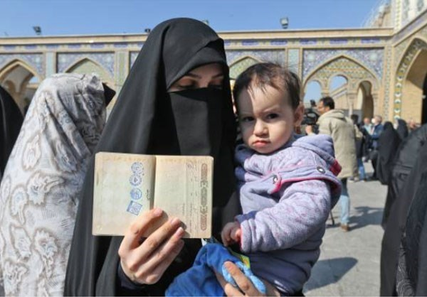 A woman poses with her child in Tehran