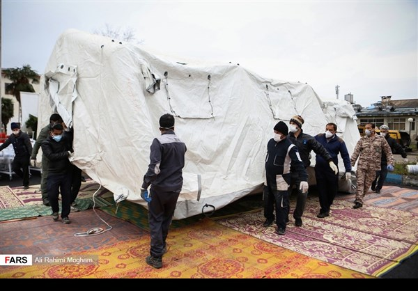 IRGC personnel set up makeshift hospital in Gilan Province.