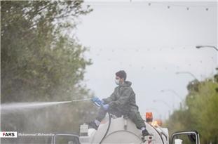 IRGC Volunteer Forces Spray Disinfectant on Tehran's Streets in Fight against Coronavirus