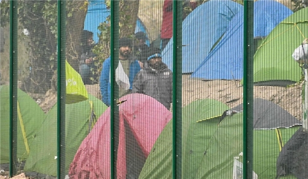 Aid Groups Warn COVID-19 Spreading Quickly Through Refugee Camps in France