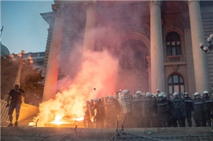 Riot Police Fire Tear Gas To Break Up Anti-Government Protests in Belgrade