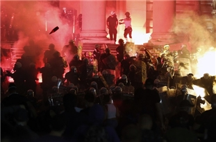 Hundreds Try to Storm Serbian Parliament as Protests Heat Up
