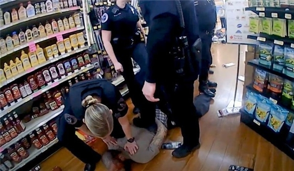 Bodycam Footage Shows Man Repeatedly Telling Arkansas Cops 'I Can't Breathe' as They Violently Pin Him to Floor