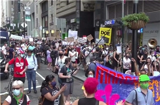 US: Protesters March Against Reopening of Schools in NYC
