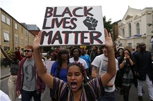 Hundreds Join Protest Against Police Brutality in UK