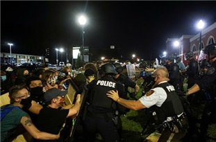 Cops in Riot Gear Clash with Protesters Outside Police Departments in Ferguson, Missouri