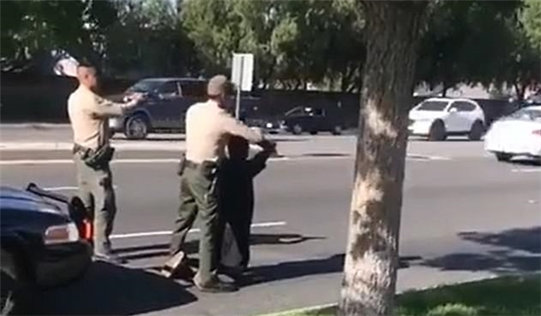 Outrage as LA Cops Filmed Aiming Their Guns at Three Black Teenagers