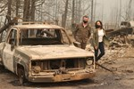 Wildfires' Aftermath in US: Burned Homes, Thick Smoke, Shattered Lives